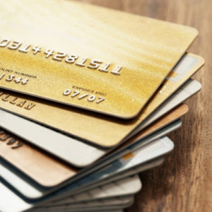 stack of gold credit cards